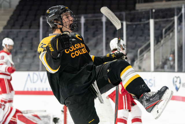 A hockey player in celebration on an ice rink
